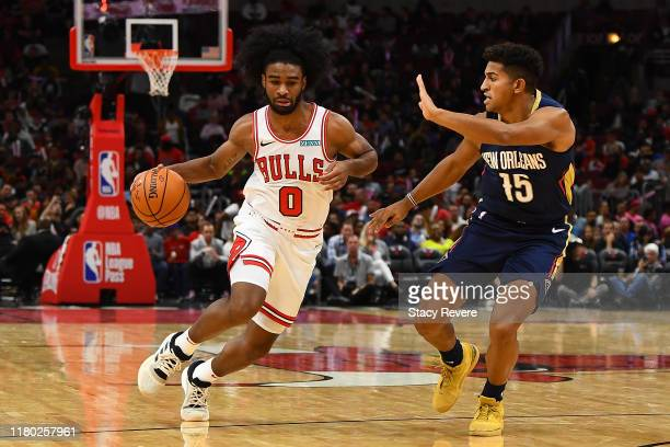 Coby White of the Chicago Bulls is defended by Frank Jackson of the New Orleans Pelicans during a preseason game at the United Center on October 09...