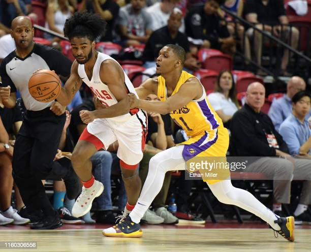 Coby White of the Chicago Bulls is fouled by Zach Norvell Jr #11 of the Los Angeles Lakers during the 2019 NBA Summer League at the Thomas Mack...