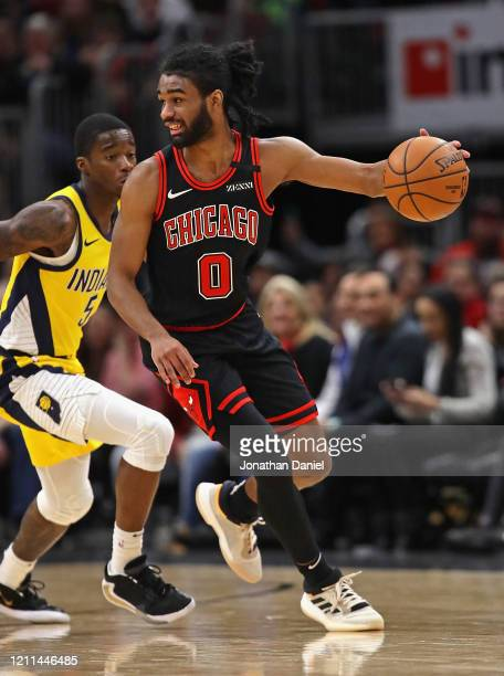 Coby White of the Chicago Bulls moves against Edmond Sumner of the Indiana Pacers at the United Center on March 06 2020 in Chicago Illinois The...