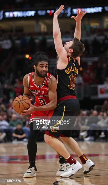 Coby White of the Chicago Bulls moves against Matthew Dellavedova of the Cleveland Cavaliers at the United Center on March 10, 2020 in Chicago,...