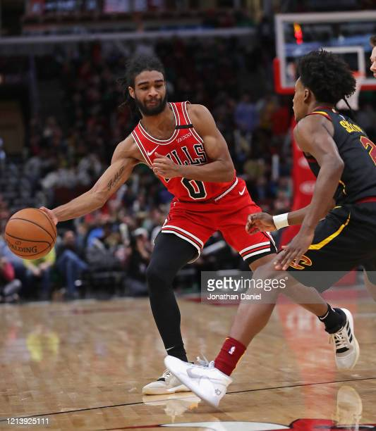 Coby White of the Chicago Bulls passes around Collin Sexton of the Cleveland Cavaliers at the United Center on March 10 2020 in Chicago Illinois The...