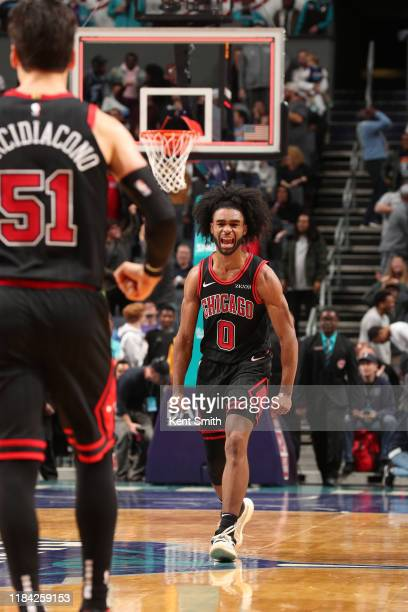 Coby White of the Chicago Bulls reacts to a play against the Charlotte Hornets on November 23 2019 at Spectrum Center in Charlotte North Carolina...