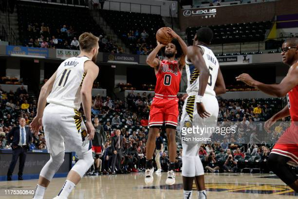Coby White of the Chicago Bulls shoots the ball against the Indiana Pacers during a preseason game on October 11 2019 at Bankers Life Fieldhouse in...