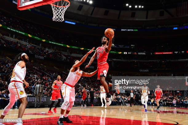Coby White of the Chicago Bulls shoots the ball during the game against the Atlanta Hawks on December 11 2019 at the United Center in Chicago...