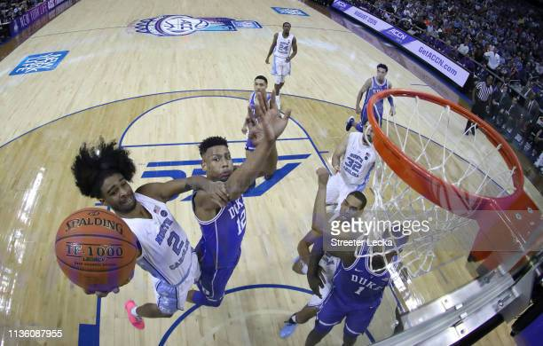 Coby White of the North Carolina Tar Heels drives to the basket against the Duke Blue Devils during their game in the semifinals of the 2019 Men's...