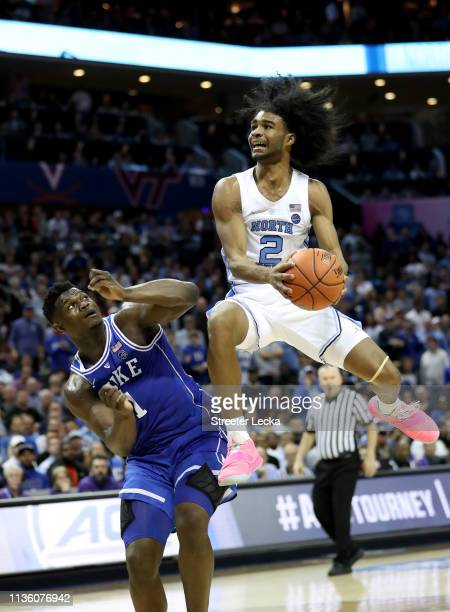 Coby White of the North Carolina Tar Heels drives to the basket against Zion Williamson of the Duke Blue Devils during their game in the semifinals...