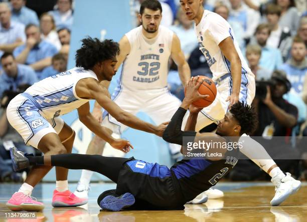Coby White of the North Carolina Tar Heels goes after a loose ball against Cam Reddish of the Duke Blue Devils during their game at Dean Smith Center...