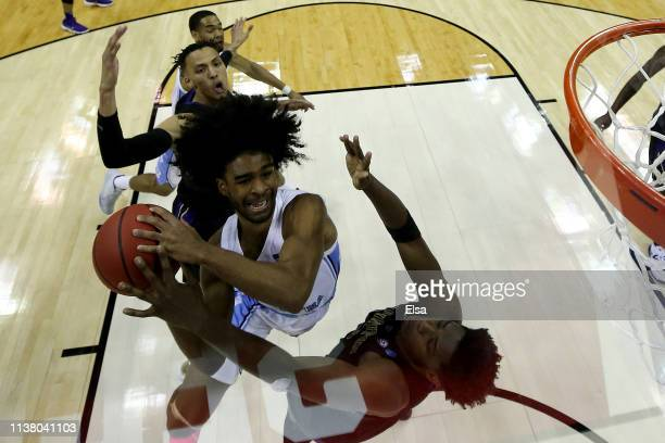 Coby White of the North Carolina Tar Heels goes up for a shot against the Washington Huskies during their game in the Second Round of the NCAA...