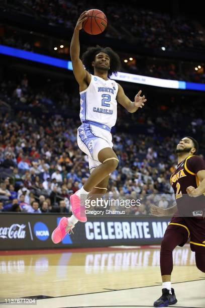 Coby White of the North Carolina Tar Heels shoots against EJ Crawford of the Iona Gaels during the second half of the game in the first round of the...