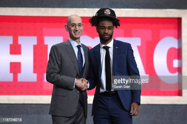 Coby White poses with NBA Commissioner Adam Silver after being drafted with the seventh overall pick by the Chicago Bulls during the 2019 NBA Draft...