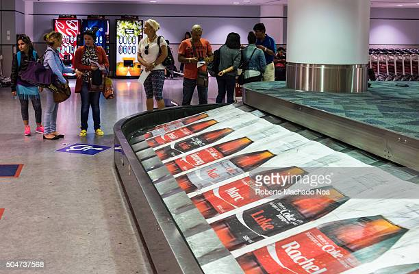 AIRPORT TORONTO ONTARIO CANADA Coca Cola advertisement in luggage conveyor belt at Pearson International Airport in TorontoCanada