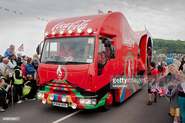 coca cola lorry in procession with the olympic flame runners - sponsra bildbanksfoton och bilder
