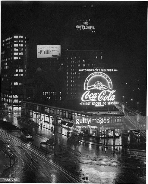 Coca Cola Neon sign at night at Columbus Circle in New York City 1930s