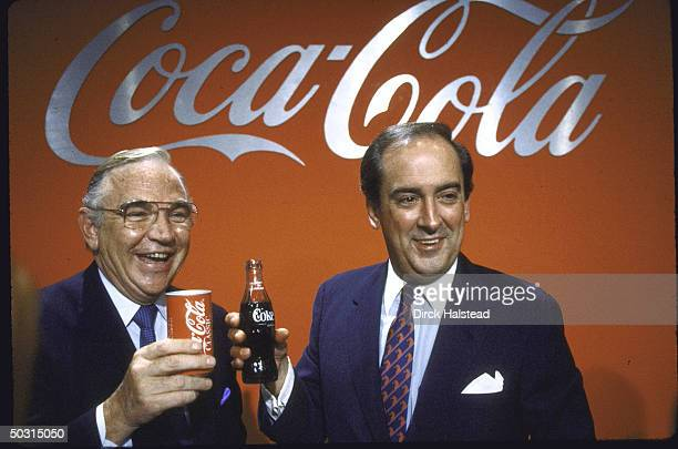 Coca Cola President Donald Keough and Chairman Roberto Goizueta raise their cokes in a toast to the switch back to Coke's original formula at a press...