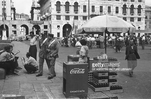 A Coca Cola stand in piazza della Vittoria International Motorcycle Rally organized to celebrate the 5th Centennial of Christopher Columbus' birth...