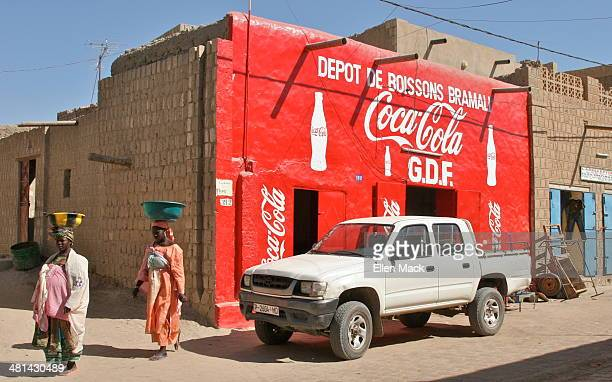 Coca-Cola advertisement is painted on the side of a building in Timbuktu. Timbuktu, Mali