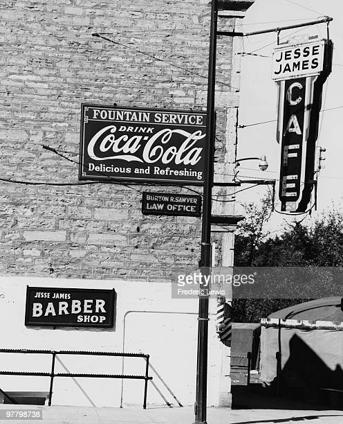 A CocaCola advertisement outside the Jesse James Cafe in Northfield Minnesota circa 1955 The infamous outlaw and his gang attempted to raid the First...