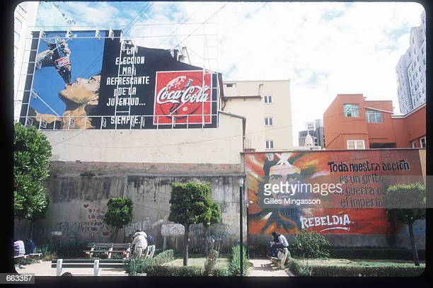 CocaCola billboard is on display near an antiimperialist mural June 15 1999 at La Paz Public University Bolivia The population of Bolivia is composed...