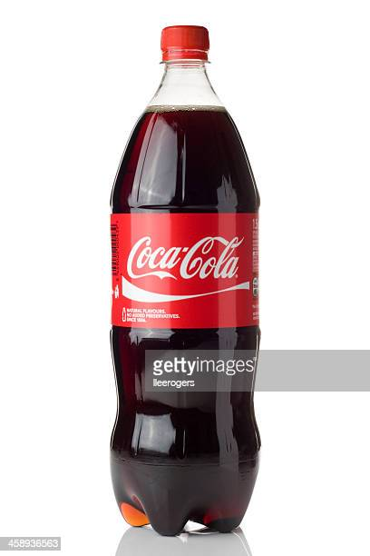 coca-cola bottle isolated on a white background - soda bottle stock photos and pictures