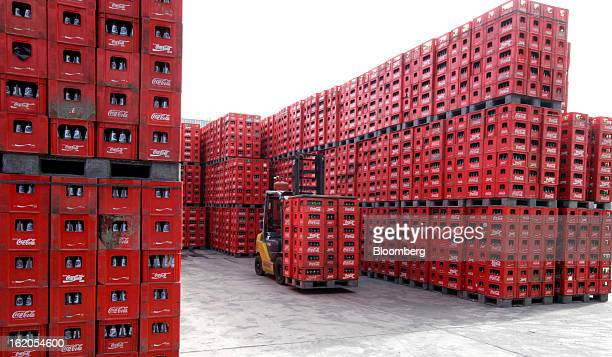 CocaCola branded crates are stacked at a CocaCola Amatil Ltd plant in Medan North Sumatra province Indonesia on Friday Feb 15 2013 CocaCola Amatil...