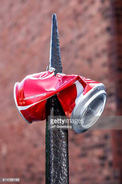 CocaCola can impaled wrought iron fence post in Lincoln Park
