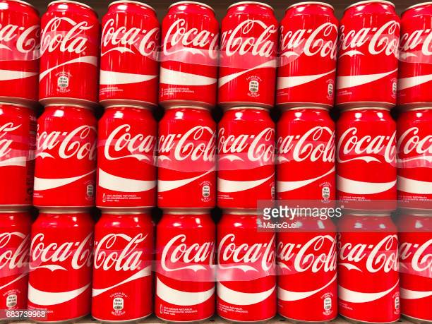 coca-cola cans in rows - pepsi stock pictures, royalty-free photos & images