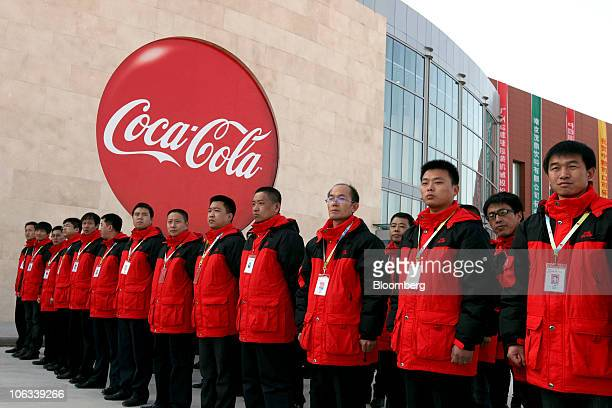 CocaCola Co staff line up outside the company's bottling plant in Hohhot Inner Mongolia China on Friday Oct 29 2010 CocaCola is opening three new...