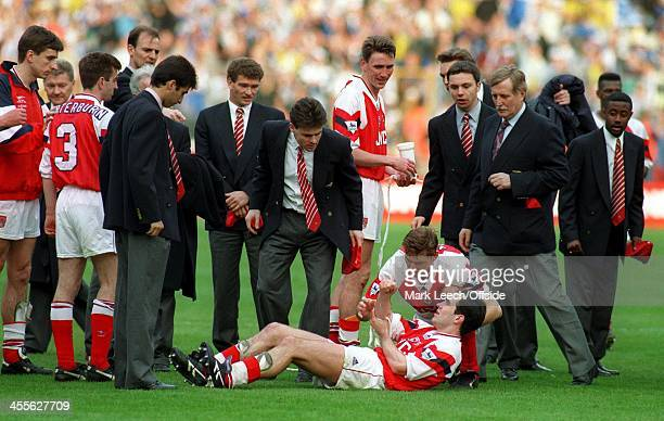CocaCola Cup 1993 Arsenal v Sheffield Wednesday Steve Morrow holds his arm after falling off of the back of Tony Adams during the celebrations