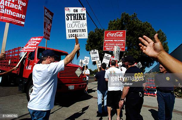 Coca-Cola employees with Teamsters Union 683, walk the picket line during a strike at the Coca Cola Bottling Co. In San Diego, California July 20,...