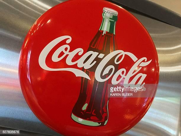 A CocaCola logo is seen in a restaurant in Washington DC May 1 2016 / AFP / Karen BLEIER