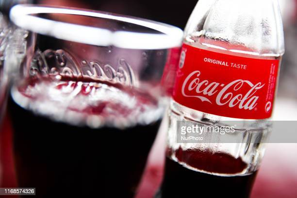 Coca-Cola logo is seen on the bottle in restaurant in Hel , Poland on 12 September 2019 .