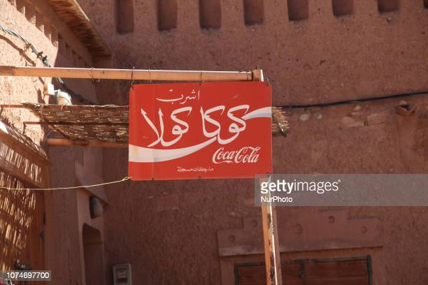 CocaCola sign outside a small shop in the historic village of Ait Benhaddou in Morocco Africa The village of Ait Benhaddou sits on top of a hill and...