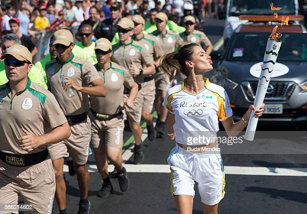 CocaCola Torch Bearer Alessandra Ambrosio has the ultimate #ThatsGold moment as she runs with the Olympic flame through Rio de Janeiro on August 5...