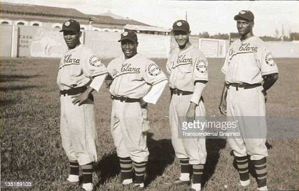 Cocaina Garcia Lazaro Salazar and Santos Amaro outfielders for the Santa Clara Leopards baseball club pose for a group portrait in Boulanger Park in...