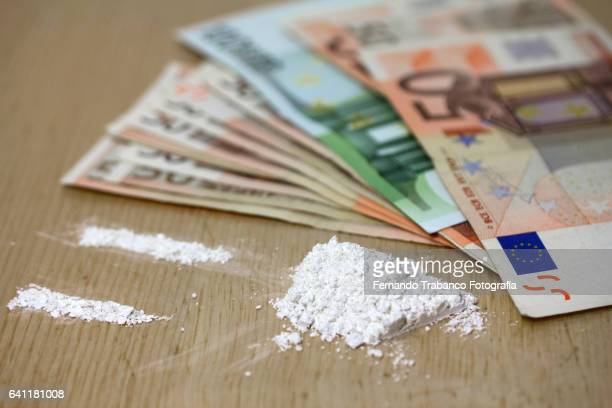 Cocaine cracks and lots of money. Drug traffic
