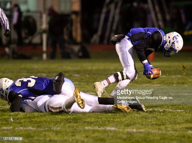 Cocalico's Marshall Patterson recovers a fumble and then runs it in for a touchdown in the second quarter. On the ground is Cocalico's Shawn Fester...