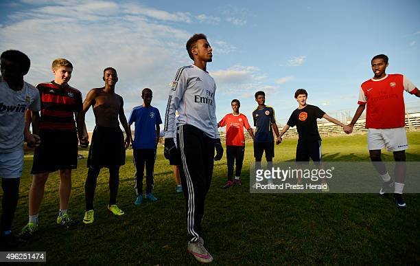 CoCaptain Abdi ShariffHassan talks with his teammates during practice Thursday November 5 2015