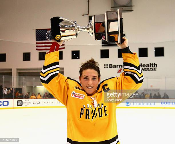 Cocaptain Hilary Knight of the Boston Pride holds up the Isobel Cup after defeating the Buffalo Beauts 31 during Game 2 of the league's inaugural...