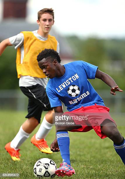 Cocaptain Joseph Kalilwa of Congo maneuvers in front of Gabriel Labonte during tryouts for the Lewiston High soccer team in Lewiston ME on Aug 17...