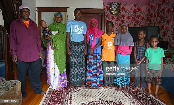 Cocaptain Maulid Abdow poses for a portrait at home with his family in Lewiston ME on Aug 16 2016 Left to right are his father Hassan Matan niece...