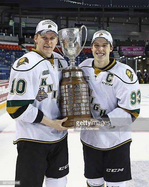 CoCaptains Christian Dvorak and Mitchell Marner of the London Knights hoist the JRoss Robertson Cup after defeating the Niagara IceDogs in Game Four...