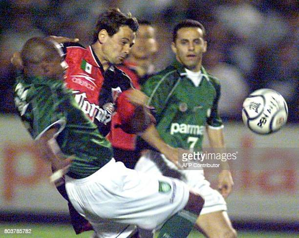 Cocca of Atlas of Mexico fights for the ball with Euler and Fernando of Palmeiras of Brazil during the quarterfinal of a soccer tournament in Sao...