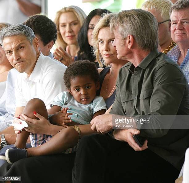 CoCEO of William Morris Endeavor Ari Emanuel actress Charlize Theron Jackson Theron and actor Sean Penn attend the Points of Light generationOn Block...