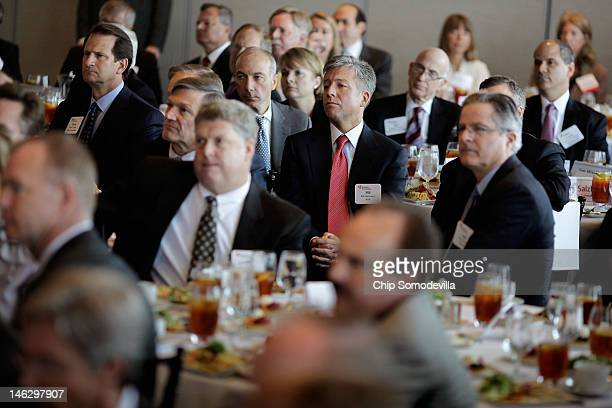 SAP coCEO William McDermott and about 100 other business executives listen to Republican presidential candidate former Massachusetts Governor Mitt...
