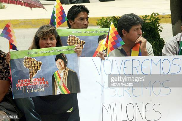 Holding Collasuyo flags and placards with the picture of President Evo Morales Aymara peasants wait 08 December 2006 for the arrival of the foreign...