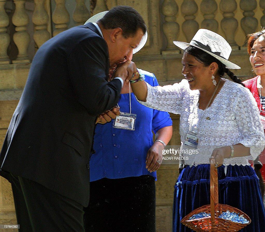 Venezuelan President Hugo Chavez kisses the hand of a quechua native,...  News Photo - Getty Images