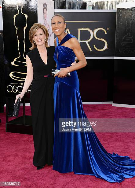 CoChair of Disney Media Networks and President of DisneyABC Television Group Anne Sweeney and TV personality Robin Roberts arrive at the Oscars at...