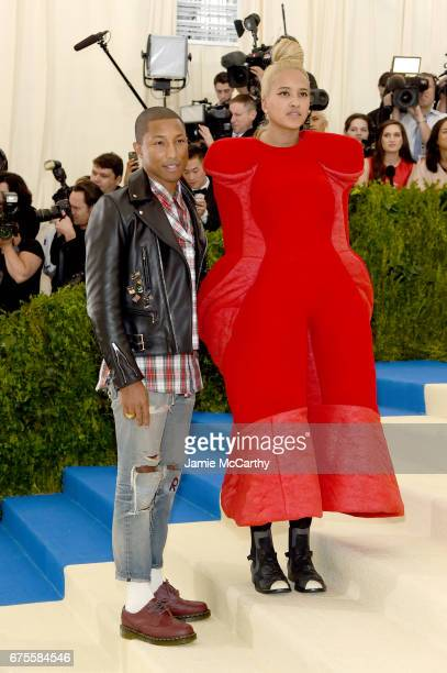 Cochair Pharrell Williams and Helen Lasichanh attends the Rei Kawakubo/Comme des Garcons Art Of The InBetween Costume Institute Gala at Metropolitan...