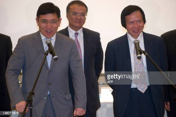 Cochairman and Managing Directors of Sun Hung Kai Properties Raymond Kwok and Thomas Kwok speak to the press after they were charged for corruption...