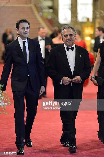CoChairman Chief Executive Officer of Fox Filmed Entertainment Jim Gianopulos and guest depart the Oscars at Hollywood Highland Center on February 24...